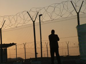 Barbed wires circulating a Palestinian crossing