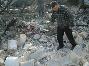 One of my cousins walking at the site of the diary wondering why do the Israelis attack the diary