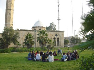 Israseli Settlers sitting in the courtyard of the Grand Mosque after being turned into musem