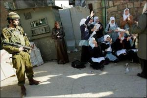 Palestinian students having their lessons at an Israeli checkpoint in the West Bank
