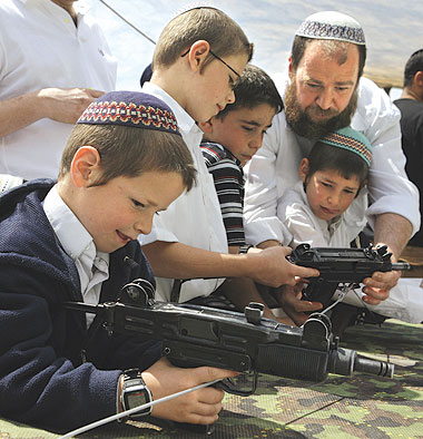 Settlers teach their kids how to use guns