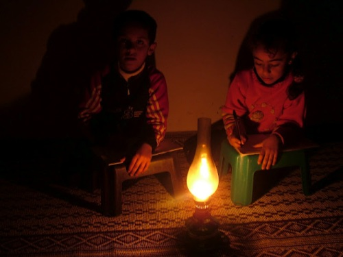My son and daughter writing their homework at the light of the candle!!!