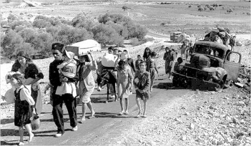 Palestinian refugees fleeing Israeli massacres in 1948